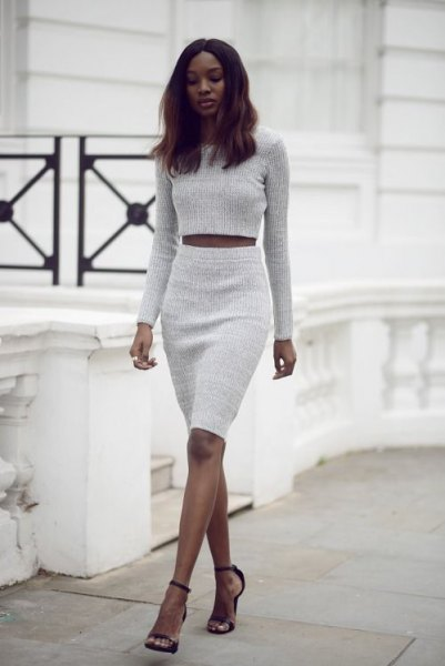 light gray cropped sweater with matching high waist skirt