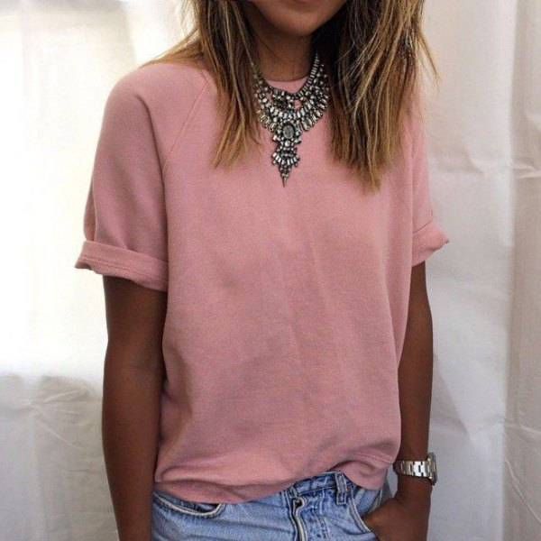 peach cuff t-shirt with tribal style statement necklace and jeans
