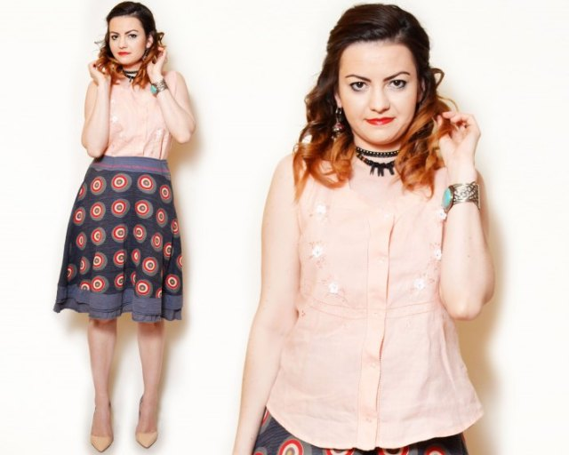 bright peach flowers with embroidered sleeveless shirt with navy printed skirt