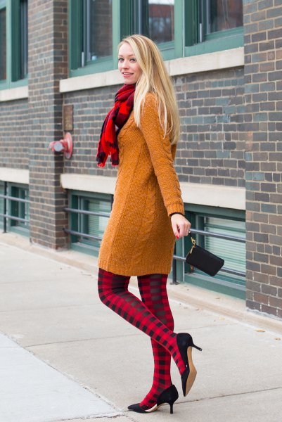 cable knit sweater with red and black checkered leggings