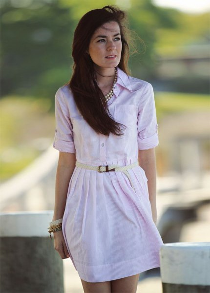 pale pink buttoned up with belt mini dress with silver statement necklace