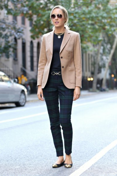 camel blazer with black tee and navy gray plaid trousers