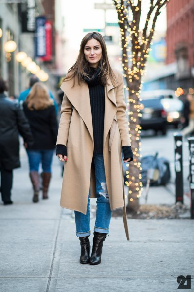 maxi camel long-line jacket with black sweater and cuffed jeans