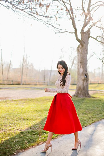 white lace blouse with red midi taffeta extended skirt