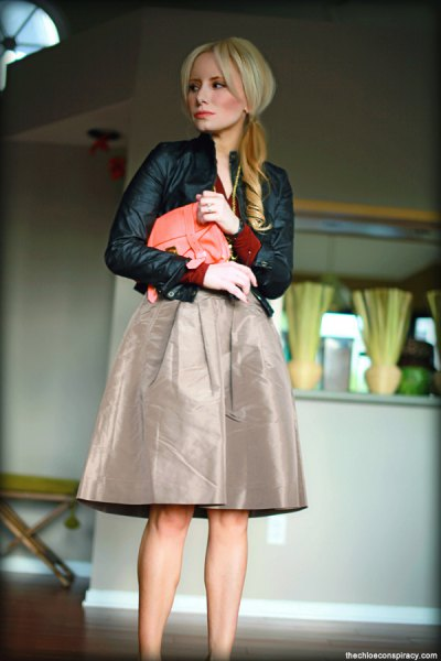 black leather jacket with gray midi-taffeta skirt
