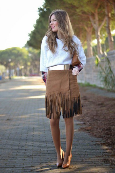 white knitted sweater with metal belt and knee length French skirt