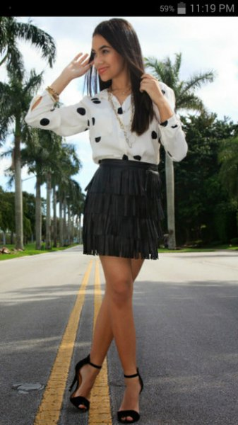 white and black polka dot shirt with mini French skirt