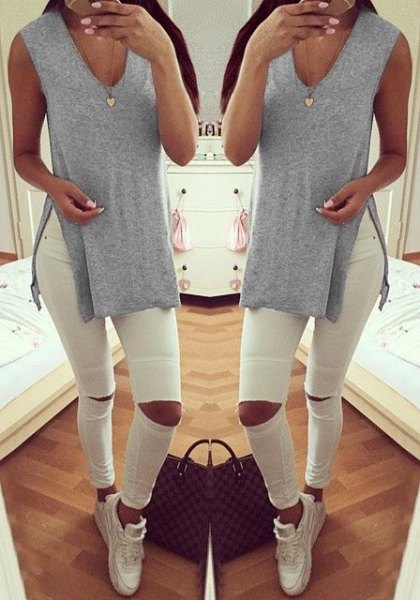 light gray v-neck v-neck shirt with white ripped jeans