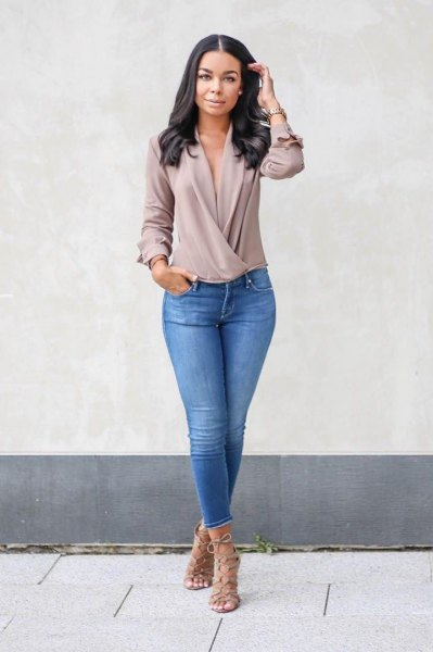 gray chiffon long sleeve twist front v-neck top with blue jeans