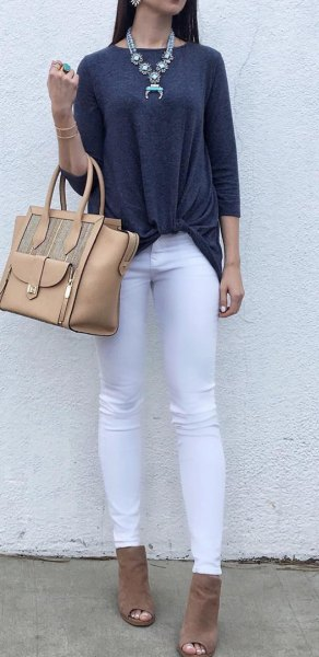 dark gray tri-colored top with white jeans and open toe boots