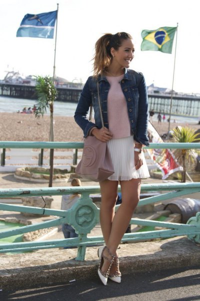 gray sweater with denim jacket and white mini chiffon-pleated skirt