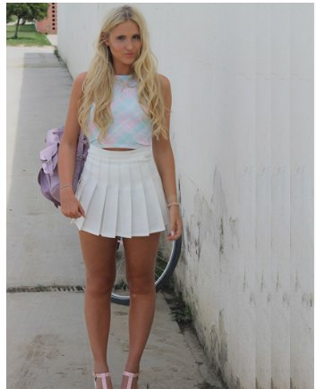 blue screwed top with cropped top with white high resolution mini-pleated skirt