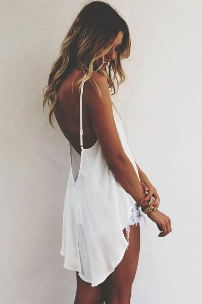 white floating backless high low tank top with denim shorts