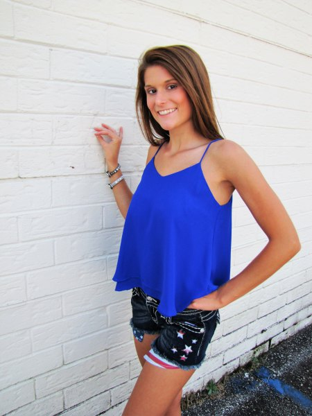 royal blue floating tank top with black embroidered mini denim shorts