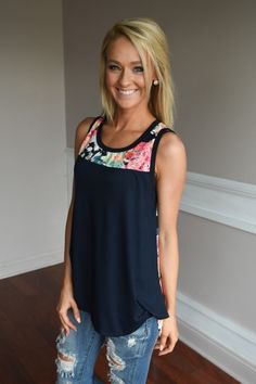 navy blue color liquid tank top with ripped jeans