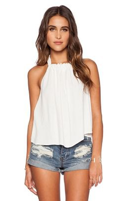 white pleated floating tank top with denim mini shorts