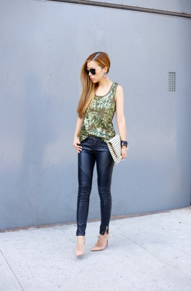 bow gold sequin with black leather trousers