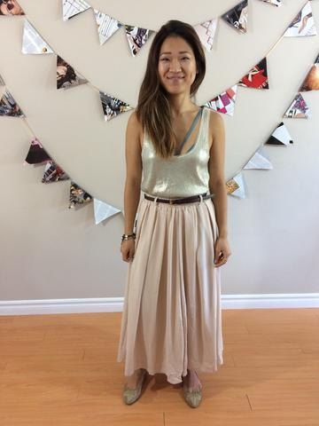silver scoop neck top with light pink maxi pleated skirt