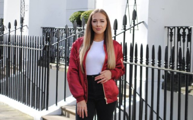 red jacket with white fit and black high waist jeans