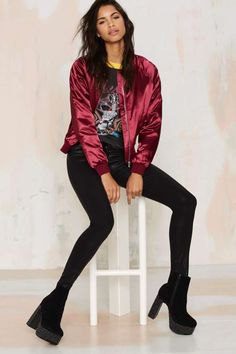 dark red bomber jacket with black print tee and slim jeans
