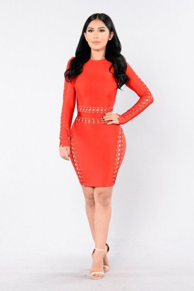 red long-sleeved bodycon dress with small cut details