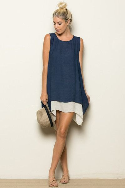 navy blue tunic shirt over white dress with mini shift