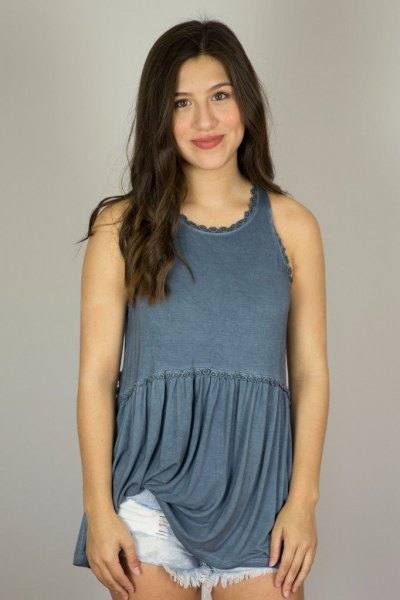 purple pleated tunic top with blue mini-denim shorts