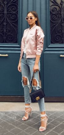 light pink satin bomber jacket with hard ripped cropped jeans