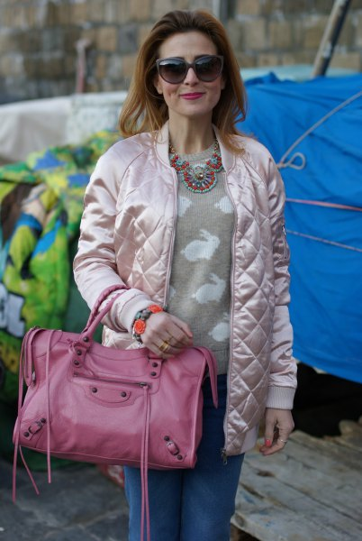 quilted white bomber jacket with pink pink sweater