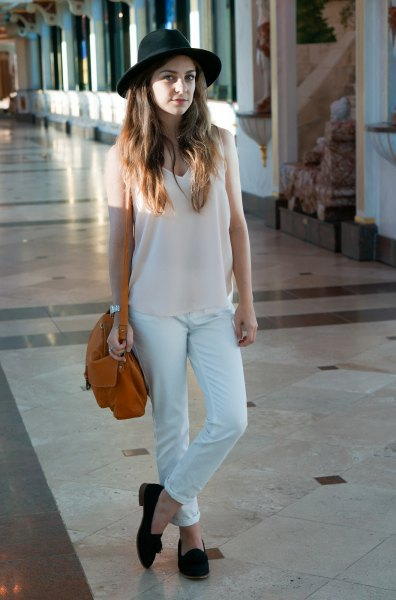 white v-long long top with matching chinos and felt hat