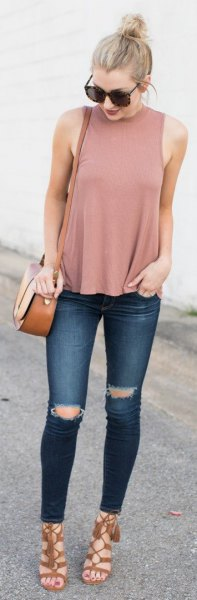 pink pink mock neck top with dark blue ripped jeans