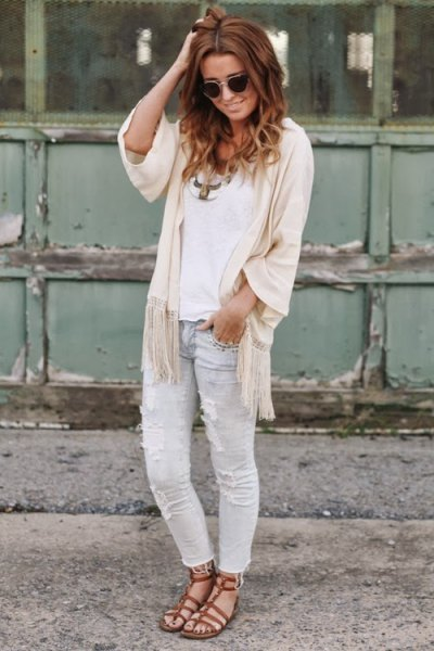 white top with ivory in half sleeve and in light gray jeans
