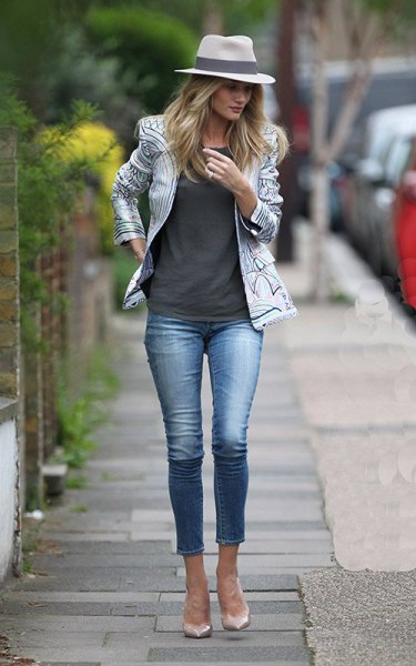 white and black printed leather jacket with gray tank top and cropped jeans