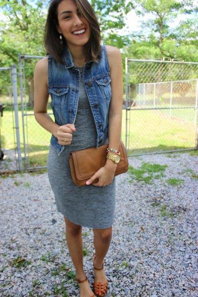 gray knee length sleeveless dress with blue denim vest