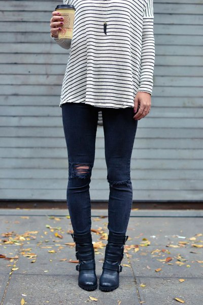 black and white striped long sleeve tee with dark blue ripped moto-jeans