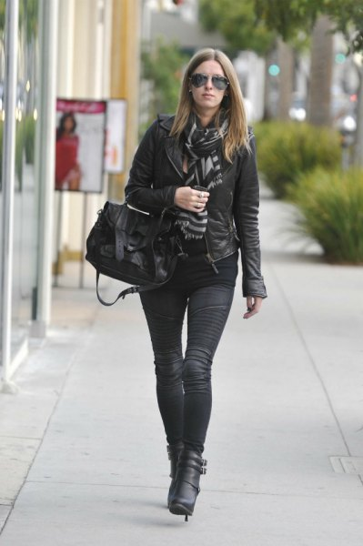 leather jacket with scarf and black moto-jeans