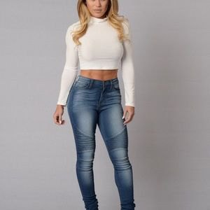 white mock neck cropped fit shirt with blue jeans in high waist