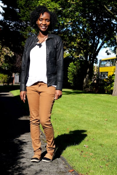 black leather jacket with white tee and straight jeans