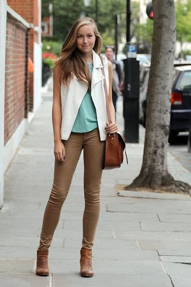 gray tank top with white vest and brown skinny jeans
