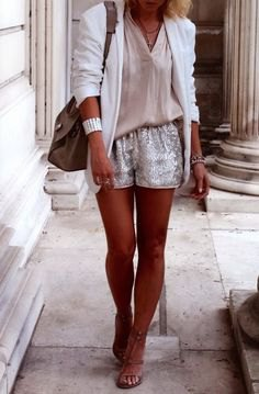 white blazer with pink blouse and shiny shorts