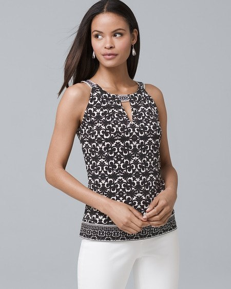 black white and silver keyhole top with white skinny jeans