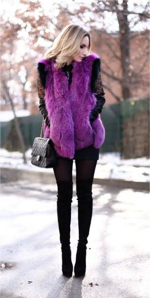 purple faux fur vest with black skinny jeans