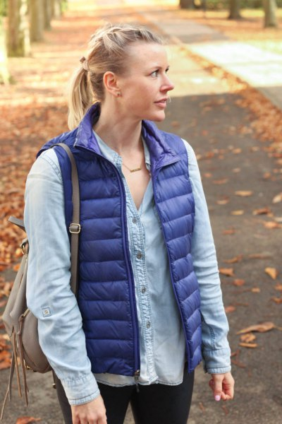 purple down vest with light blue chambray button