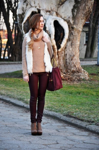 black coated jeans with pink pink sweater and white vest
