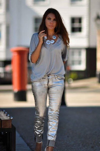 gray v-neck half sleeve T-shirt with silver cuffed jeans