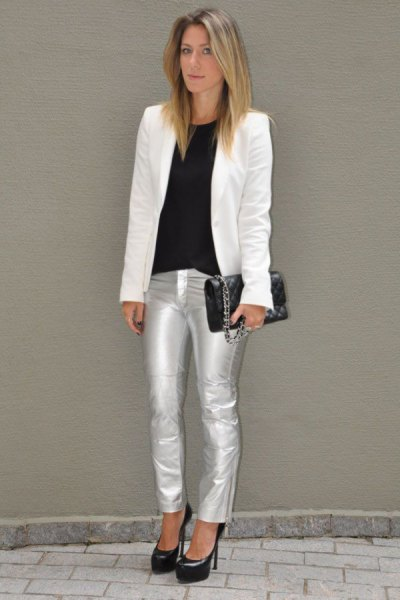 white blazer with black top on neck and silver metallic jeans