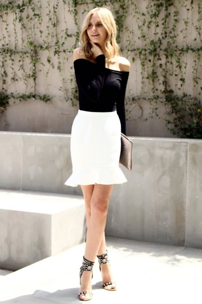 black of shoulder blouse with white mini mermaid skirt