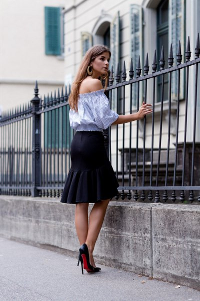 sky blue from shoulder-length blouse with black knee length skirt