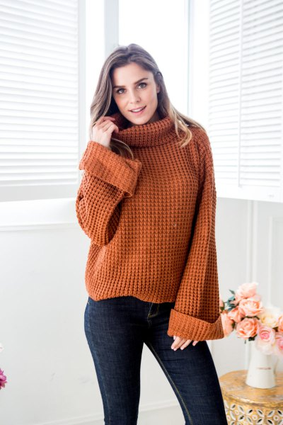 brown turtleneck chunky knit sweater with dark blue skinny jeans