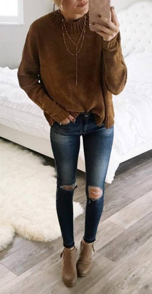 brown mock neck knit sweater with blue ripped skinny jeans